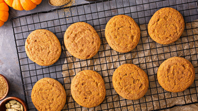 Fall snickerdoodle cookies with pumpkin and cinnamon overhead shot_377819