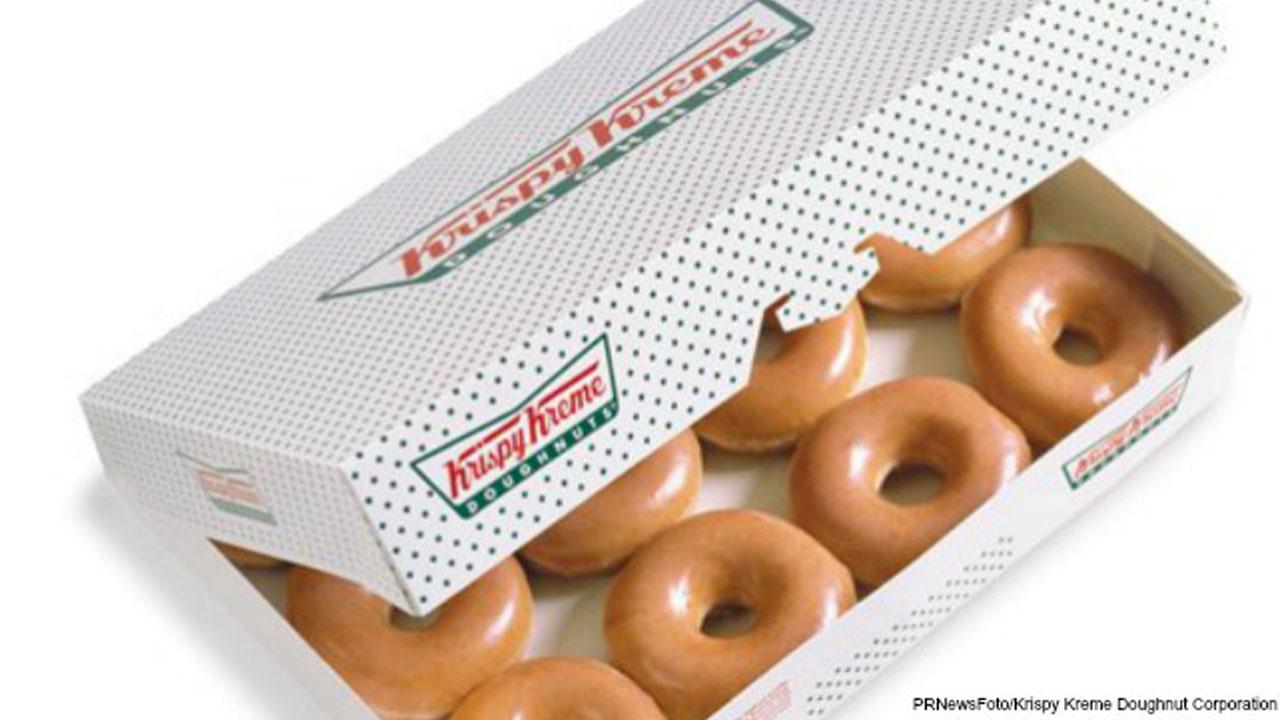 dozen Krispy Kreme donuts_416670-846624087