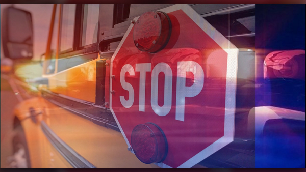 SCHOOL BUS WITH RED AND BLUE POLICE LIGHTS_graphic_FORMATTED FOR WEB_1554495646520.jpg.jpg