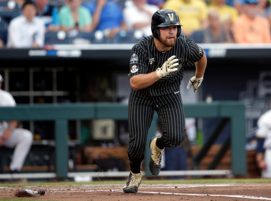 Vanderbilt's Stephen Scott runs off a base hit against Michigan in the second inning of Game 2 of the NCAA College World Series baseball finals in Omaha, Neb., Tuesday, June 25, 2019. (AP Photo/Nati Harnik)