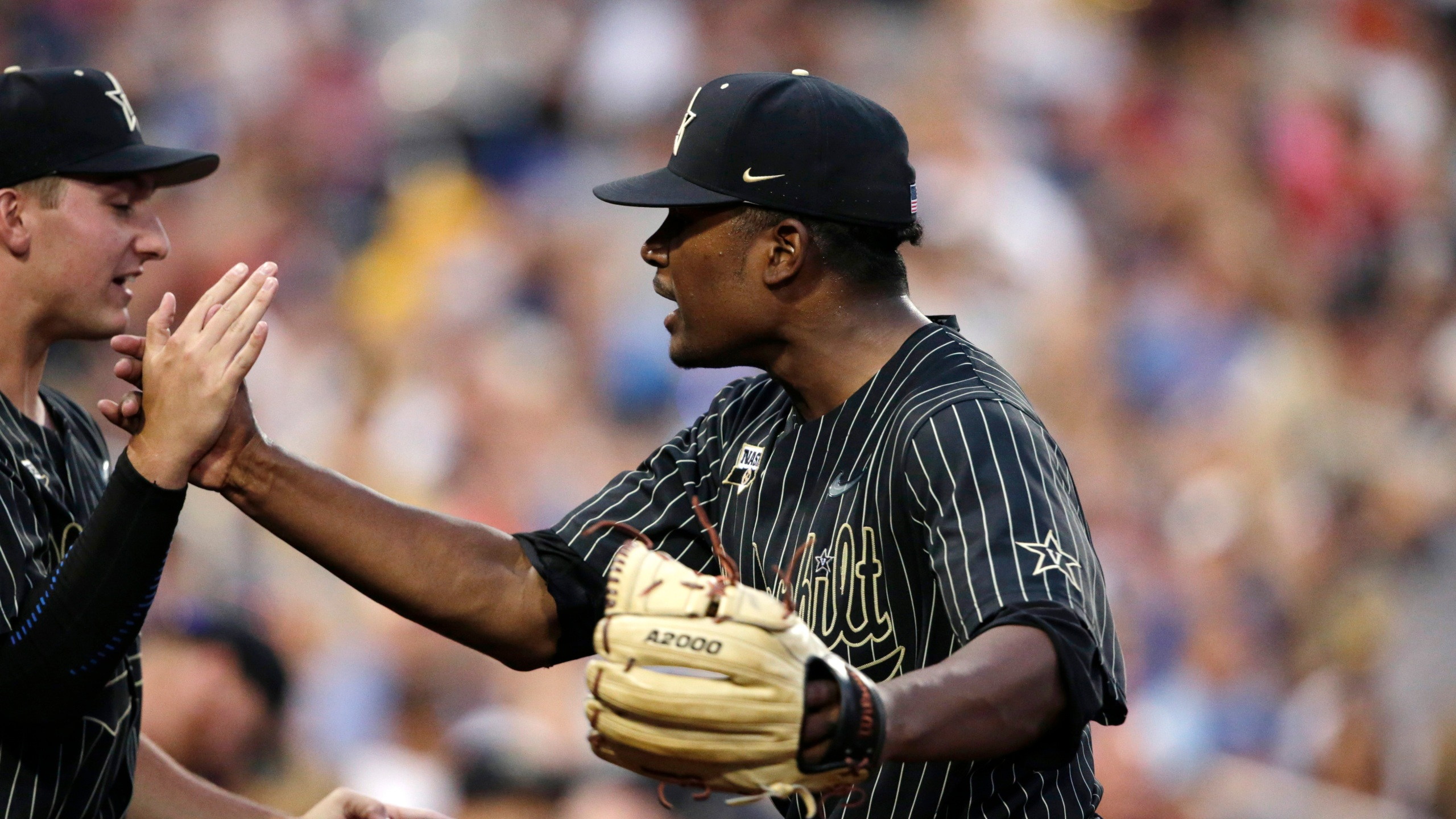 Vanderbilt pitcher Kumar Rockeer reacts at the end of the sixth inning against Michigan in Game 2 of the NCAA College World Series baseball finals in Omaha, Neb., Tuesday, June 25, 2019. (AP Photo/Nati Harnik)