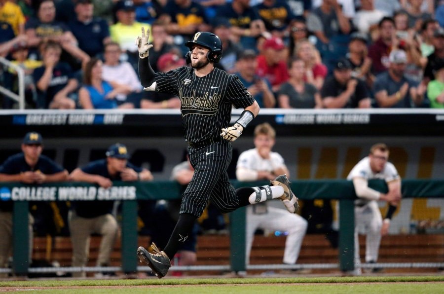 Vanderbilt's Philip Clarke, center, celebrates his solo homer in the seventh inning against Michigan in Game 2 of the NCAA College World Series baseball finals in Omaha, Neb., Tuesday, June 25, 2019. (AP Photo/Nati Harnik)