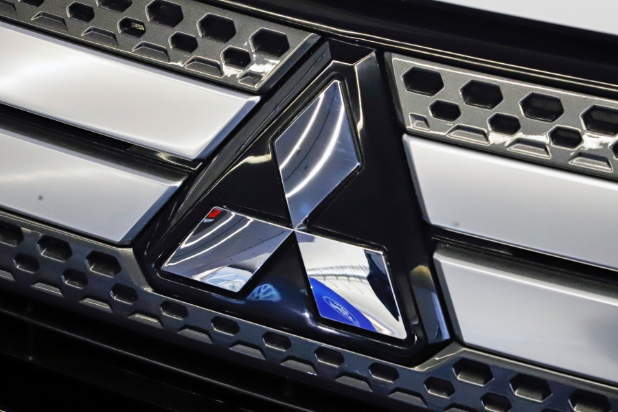 FILE - This Feb. 14, 2019, file photo shows the Mitsubishi logo on the front grill of a 2019 Mitsubishi Outlander GT (AP Photo/Gene J. Puskar, File)